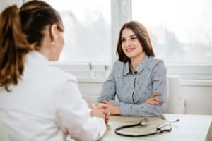 woman consults physician for STD testings
