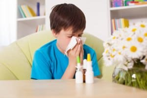 young boy with seasonal allergies