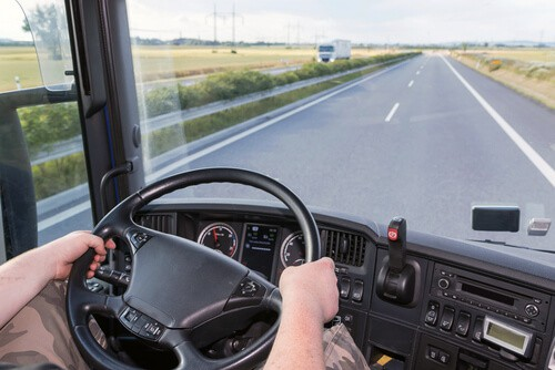 commercial driver with CDL drives large truck